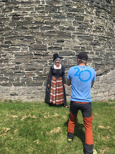 Photographer takes photo of Welsh Lady outside Conwy walls